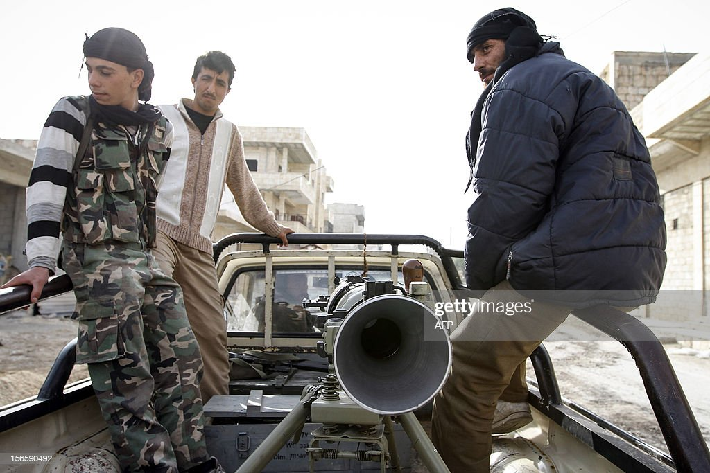 Rebels in Maraat al-Numan move toward the frontline with a newly-acquired SPG-9 rocket launcher on their pick-up truck, on November 17, 2012. After months of repeated airstrikes and artillery barrages by Syrian forces outside Maraat al-Numan, fighting for this crucial town on the Aleppo-Damascus highway shows little sign of abating. The Free Syrian Army control the town, but the Syrian army are free to bombard it at will.