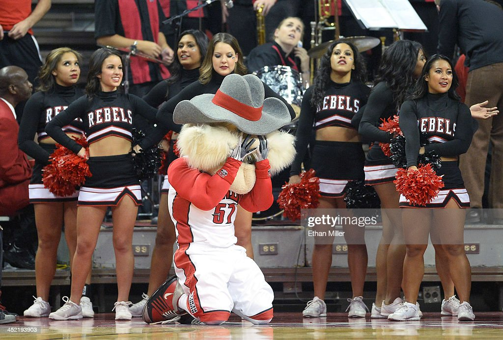 Rebels mascot Hey Reb and cheerleaders react during the team's game against the Illinois Fighting Illini at the Thomas & Mack Center on November 26, 2013 in Las Vegas, Nevada. Illinois won 61-59.