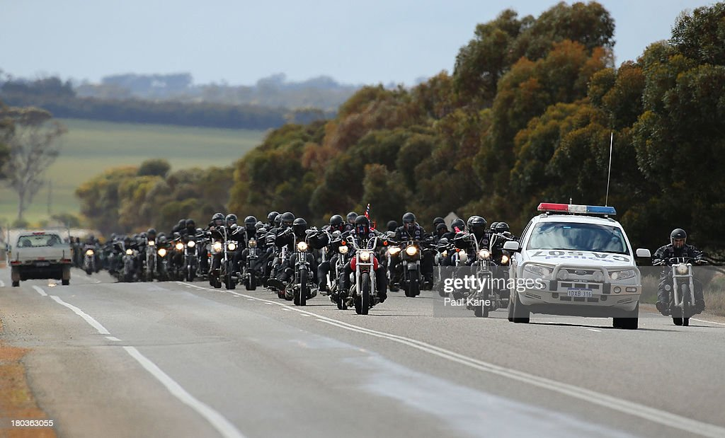 A Rebels motorcycle club members ride to Tammin onroute to Perth on September 12, 2013 in Perth, Australia. An estimated 1000 Rebels from chapters all over Australia gather for the road trip across the country to Perth.