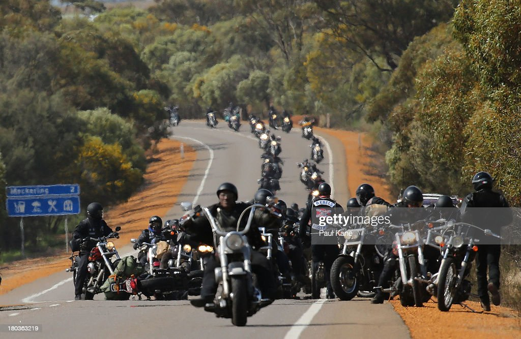 Rebels motorcycle club members stop to assist a rider who was involved in accident on their ride from Meckering to Perth on September 12, 2013 in Perth, Australia. An estimated 1000 Rebels from chapters all over Australia gather for the road trip across the country to Perth.
