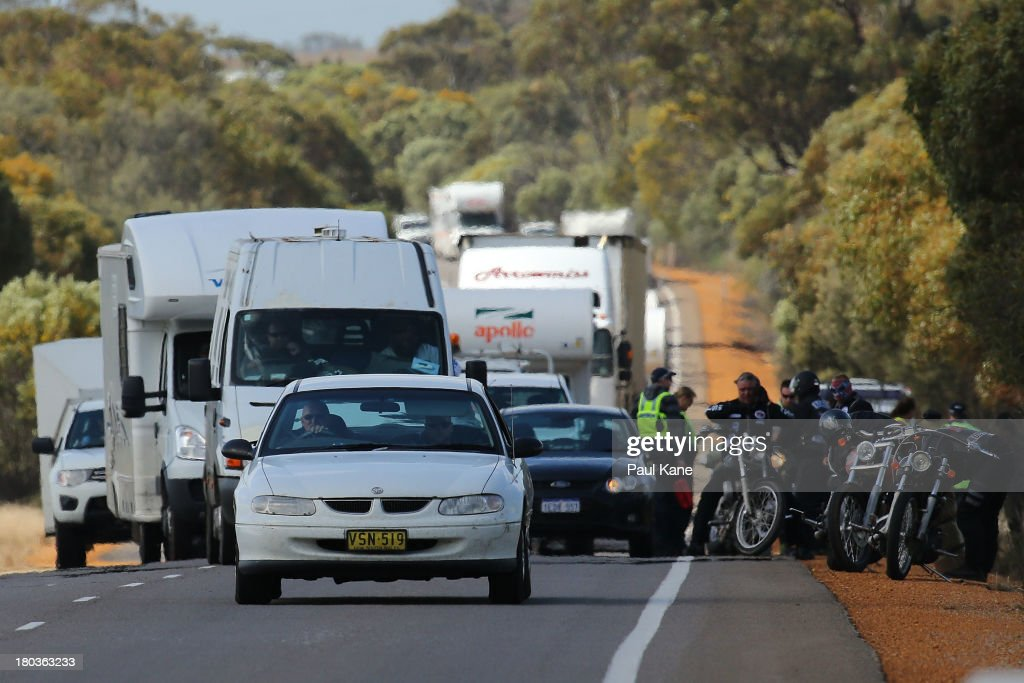 Rebels motorcycle club members support vehicles follow the main group as Police and other members stop to assist a rider who was involved in accident on the ride from Meckering to Perth on September 12, 2013 in Perth, Australia. An estimated 1000 Rebels from chapters all over Australia gather for the road trip across the country to Perth.
