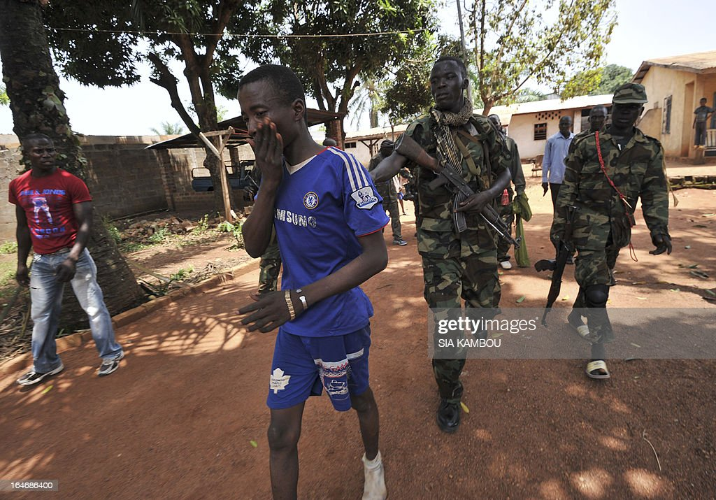 Rebels of the Seleka coalition arrest a man, claiming to belong to the Seleka movement, suspected of looting a house in a popular neighbourood of Bangui on March 26, 2013. Central African Republic strongman Michel Djotodia was set to unveil a new government on March 26 after declaring he would rule by decree following the latest coup in the notoriously unstable nation. Looters were on the rampage in the capital Bangui after Djotodia's Seleka rebel coalition seized control in a rapid-fire weekend assault that forced president Francois Bozize into exile and was condemned by the international community.
