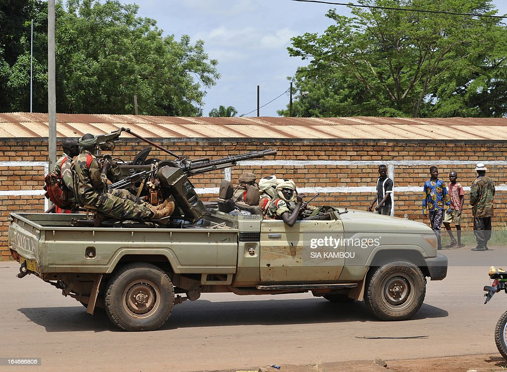 Rebels of the Seleka coalition sit on pick up truck mounted with a machine gun as they patrol Bangui on March 26, 2013. Central African Republic strongman Michel Djotodia was set to unveil a new government on March 26 after declaring he would rule by decree following the latest coup in the notoriously unstable nation. Looters were on the rampage in the capital Bangui after Djotodia's Seleka rebel coalition seized control in a rapid-fire weekend assault that forced president Francois Bozize into exile and was condemned by the international community.