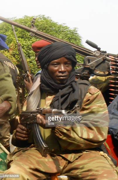 SELEKA rebels patrol on roads 12kms away from the Central African Republican city of Damara on January 8 2013 Threeway peace talks between the...