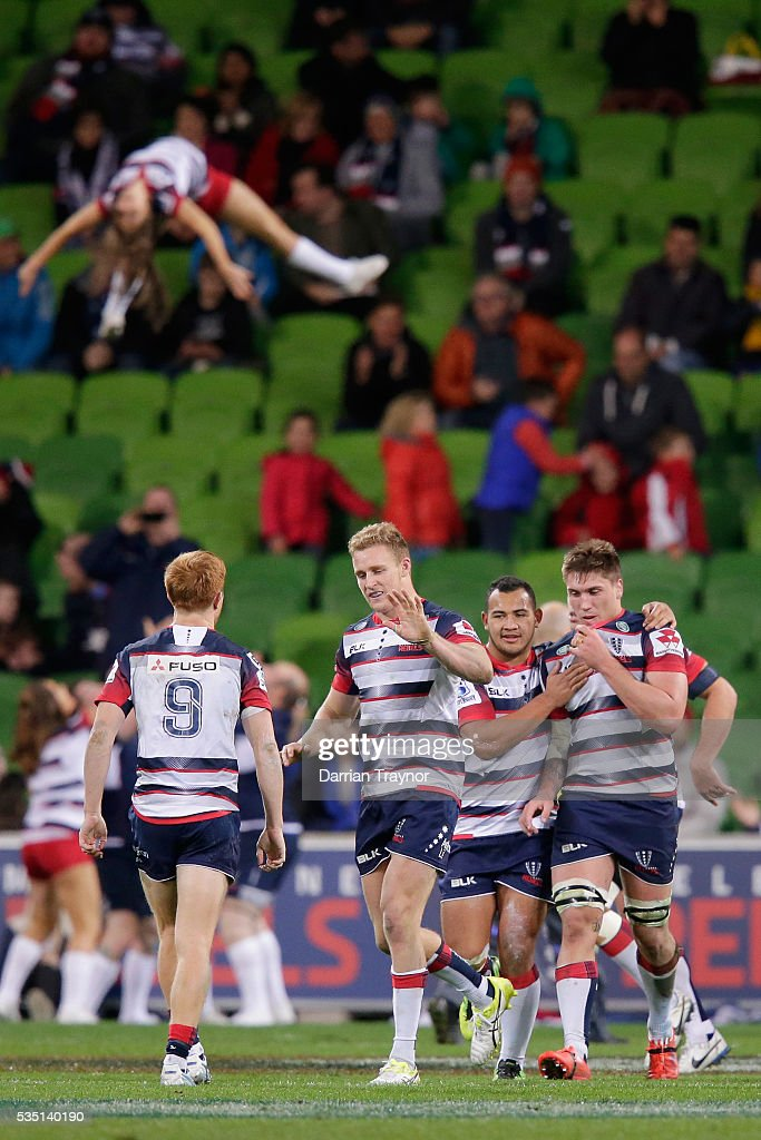 Rebels players celebrate a try during the round 14 Super Rugby match between the Rebels and the Force at AAMI Park on May 29, 2016 in Melbourne, Australia.