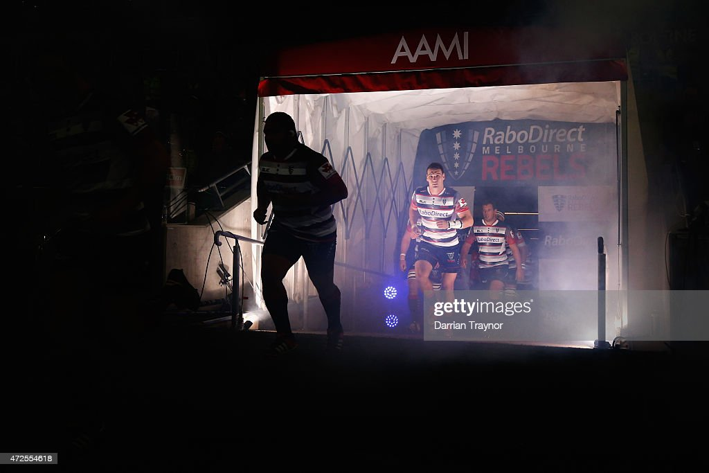 Rebels players run out before the round 13 Super Rugby match between the Rebels and the Blues at AAMI Park on May 8 2015 in Melbourne Australia