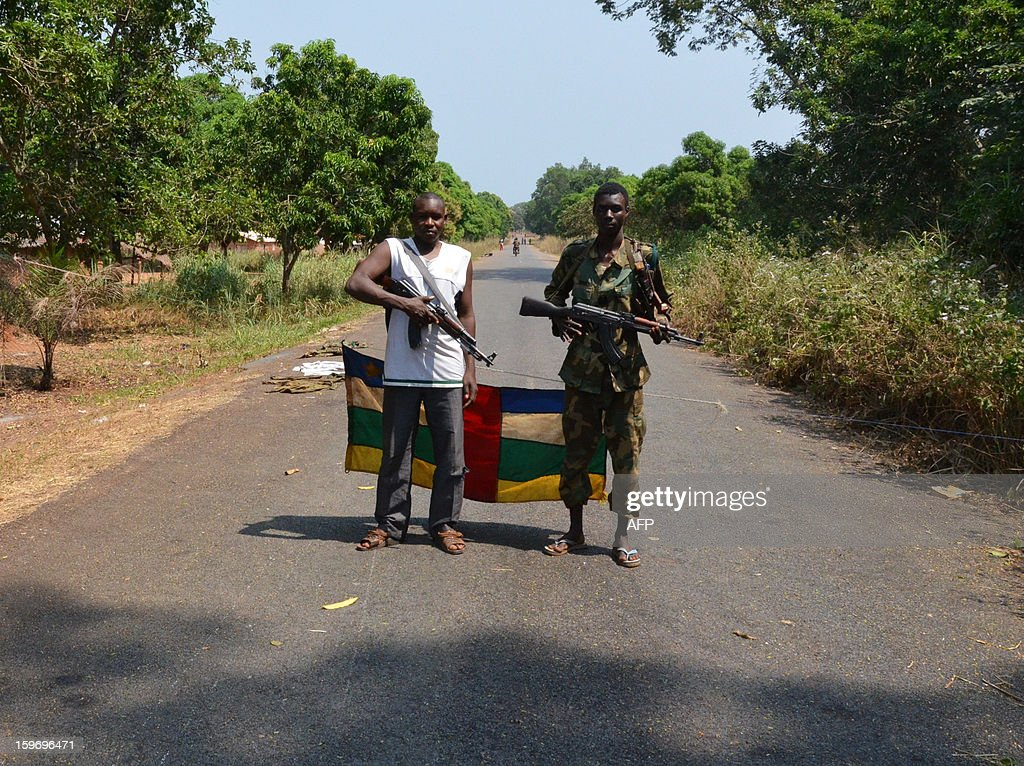 Rebels stand guard at a checkpoint near Damara, on January 18, 2013. Central African Republic President Francois Bozize officially appointed opposition figure Nicolas Tiangaye prime minister of the country's new national unity government Thursday, in line with a peace deal struck with rebels last week. The move complied with an accord reached between the ruling party, the rebel groups and the democratic opposition in the Gabonese capital of Libreville last week which seeks to bring peace to the unstable, impoverished nation and allowed for the opposition to choose a new premier.