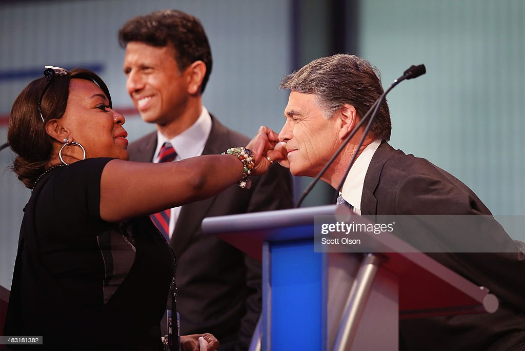 Rebulican presidential candidate Rick Perry gets his makeup retouched during a break in a presidential forum hosted by FOX News and Facebook at the...