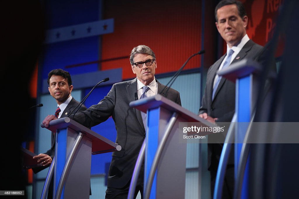 Rebulican presidential candidates Louisiana Gov Bobby Jindal Rick Perry and Rick Santorum listen as Carly Fiorina fields a question during a...