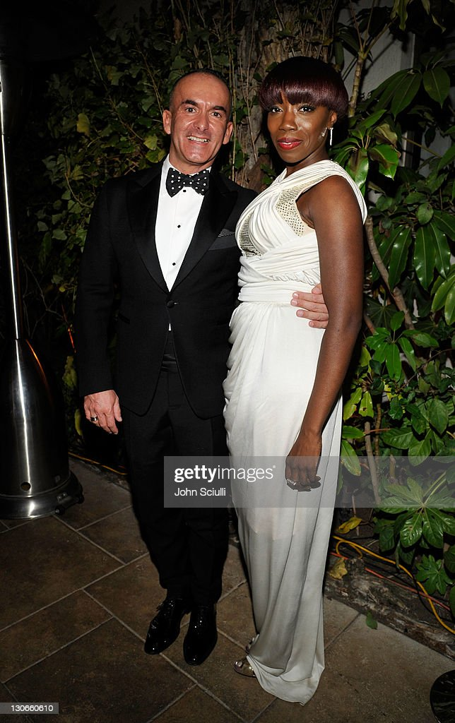Reca Group President Paolo Diacci and singer Esgtelle attend the The 2011 amfAR Inspiration Gala held at the Chateau Marmont on October 27 2011 in...