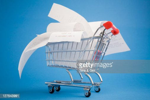 Receipts in shopping cart : Stock Photo