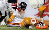 Receiver Arrelious Benn of the Tampa Bay Buccaneers dives for the endzone as defensive back Brent Grimes of the Atlanta Falcons pushes him out of...