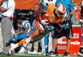 Receiver Arrelious Benn of the Tampa Bay Buccaneers is tackled after a catch by defender Charles Godfrey of the Carolina Panthers during the game at...