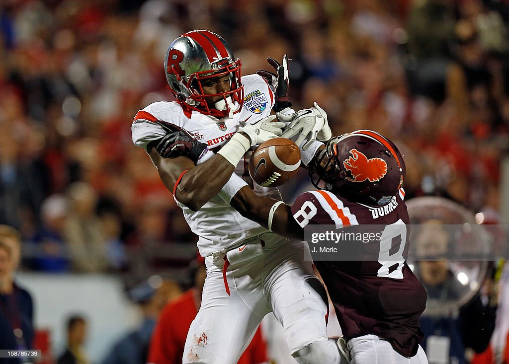 Receiver Brandon Coleman #17 of the Rutgers Scarlet Knights cannot come up with this pass as defender Detrick Bonner #8 of the Virginia Tech Hokies breaks it up during the Russell Athletic Bowl Game at the Florida Citrus Bowl on December 28, 2012 in Orlando, Florida.