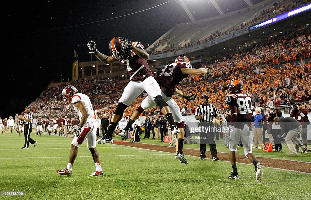 Receiver Corey Fuller #83 of the Virginia Tech Hokies celebrates his touchdown catch with Marcus Davis #7 during the Russell Athletic Bowl Game against the Rutgers Scarlet Knights at the Florida Citrus Bowl on December 28, 2012 in Orlando, Florida.