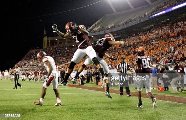Receiver Corey Fuller of the Virginia Tech Hokies celebrates his touchdown catch with Marcus Davis during the Russell Athletic Bowl Game against the...