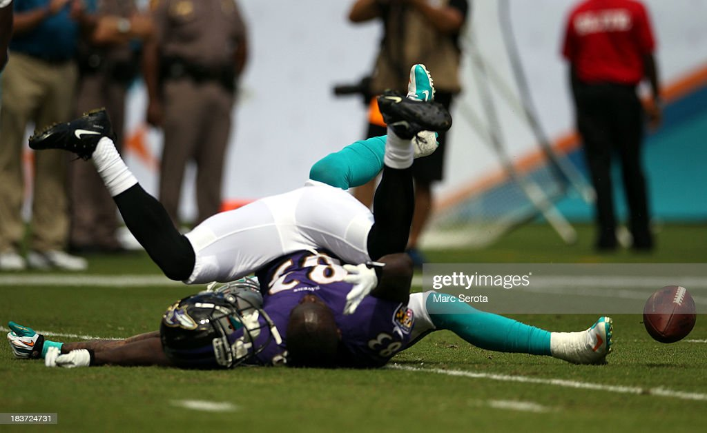 Receiver Deonte thompson #83 of the Baltimore Ravens reacts after he cannot make a catch against <a gi-track='captionPersonalityLinkClicked' href=/galleries/search?phrase=Reshad+Jones&family=editorial&specificpeople=4511449 ng-click='$event.stopPropagation()'>Reshad Jones</a> #20 of the Miami Dolphins at Sun Life Stadium on October 6, 2013 in Miami Gardens, Florida. The Ravens defeated the Dolphins 26-23.