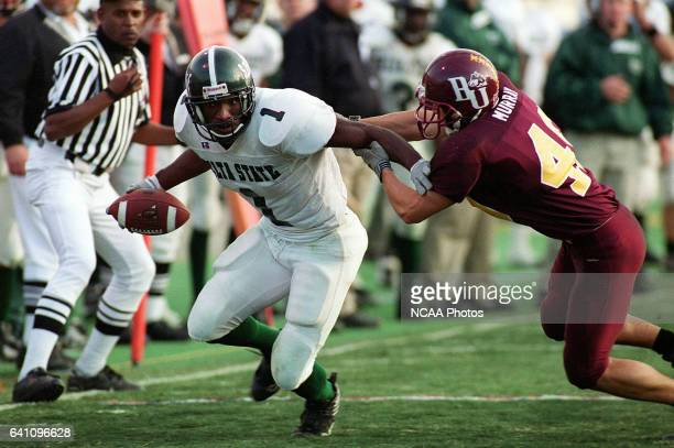 Receiver Jason Franklin of Delta State picks up a 21yard gain against cornerback Luke Murray of Bloomsburg during the Division 2 Men's Football...