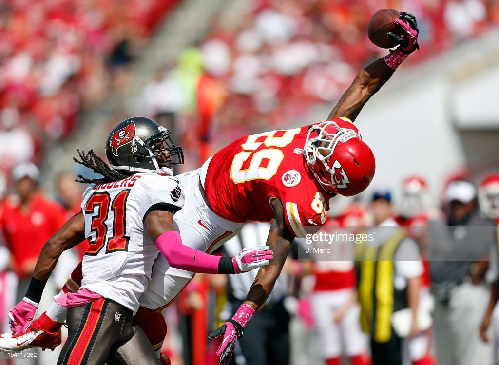Receiver Jon Baldwin #89 of the Kansas City Chiefs cannot come up with this pass as defender E.J. Biggers #31 of the Tampa Bay Buccaneers looks on during the game at Raymond James Stadium on October 14, 2012 in Tampa, Florida.
