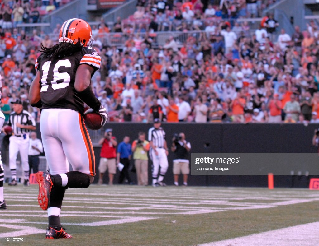 Receiver Josh Cribbs of the Cleveland Browns celebrates after scoring a touchdown during a game with the Cleveland Browns at Cleveland Browns Stadium...