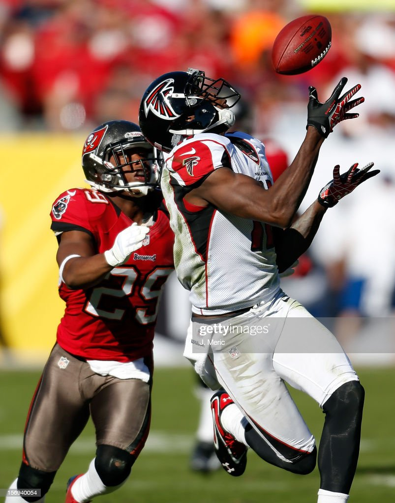 Receiver <a gi-track='captionPersonalityLinkClicked' href=/galleries/search?phrase=Julio+Jones&family=editorial&specificpeople=5509837 ng-click='$event.stopPropagation()'>Julio Jones</a> #11 of the Atlanta Falcons catches a third quarter touchdown pass in front of defender Leonard Johnson #29 of the Tampa Bay Buccaneers during the game at Raymond James Stadium on November 25, 2012 in Tampa, Florida.