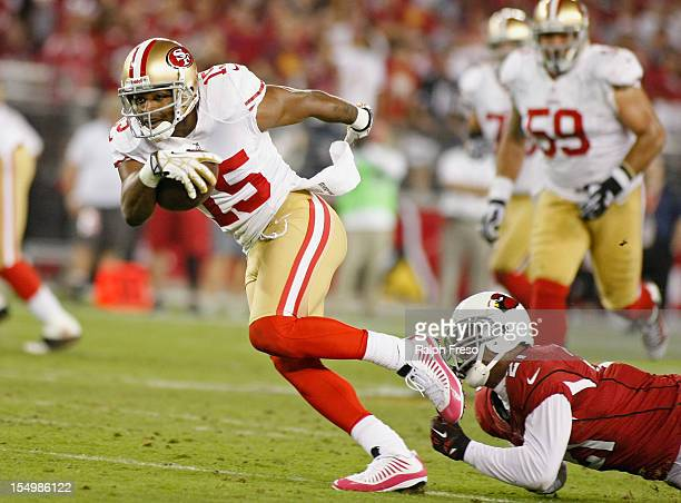 Receiver Michael Crabtree of the San Francisco 49ers slips out of the tackle of Patrick Peterson of the Arizona Cardinals after a catch during the...