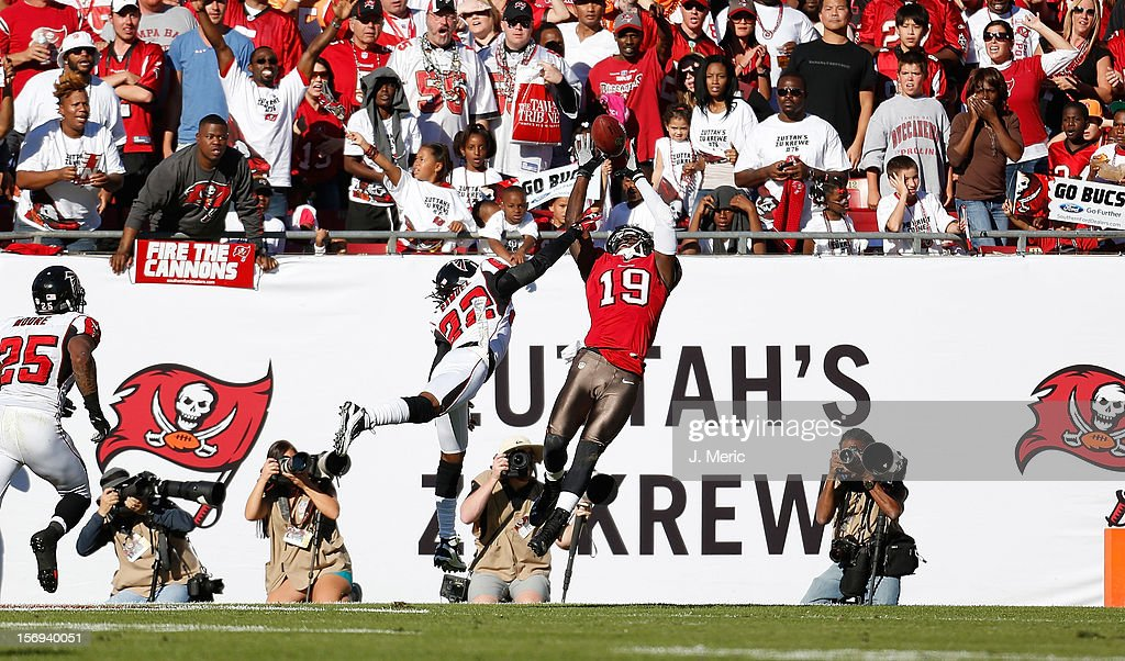 Receiver Mike Williams #19 of the Tampa Bay Buccaneers cannot come up with this catch as defensive back Asante Samuel #22 of the Atlanta Falcons defends during the game at Raymond James Stadium on November 25, 2012 in Tampa, Florida.