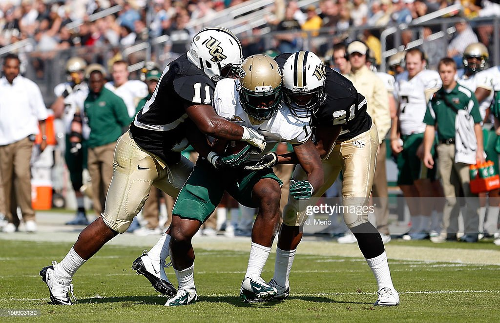 Receiver Patrick Hearn #16 of the Alabama Birmingham Blazers is sandwiched between defenders <a gi-track='captionPersonalityLinkClicked' href=/galleries/search?phrase=Jonathan+Davis&family=editorial&specificpeople=221592 ng-click='$event.stopPropagation()'>Jonathan Davis</a> #11 and A.J. Bouye #21 of the Central Florida Knights during the game at Bright House Networks Stadium on November 24, 2012 in Orlando, Florida.