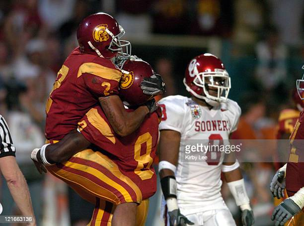 USC receiver Steve Smith jumps in the arms of Dwayne Jarrett after a touchdown in 5519 victory over Oklahoma in the FedEx Orange Bowl at Pro Player...
