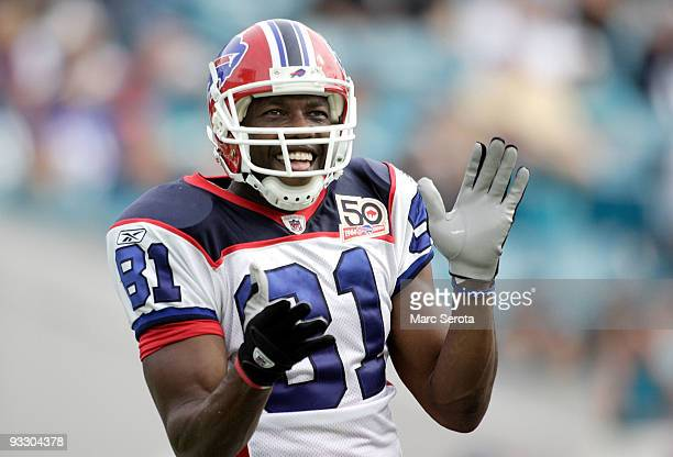 receiver Terrell Owens of the Buffalo Bills celebrates a touchdown against the Jacksonville Jaguars at Jacksonville Municipal Stadium on November 22...