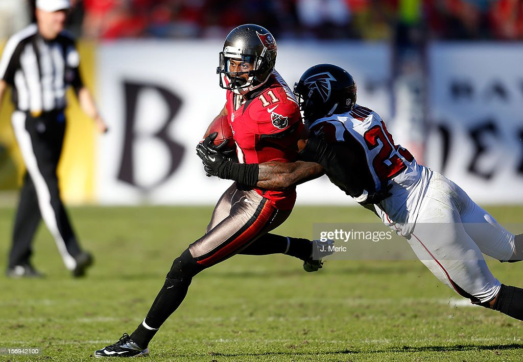 Receiver Tiquan Underwood #11 of the Tampa Bay Buccaneers is tackled by defensive back William Moore #25 of the Atlanta Falcons during the game at Raymond James Stadium on November 25, 2012 in Tampa, Florida.