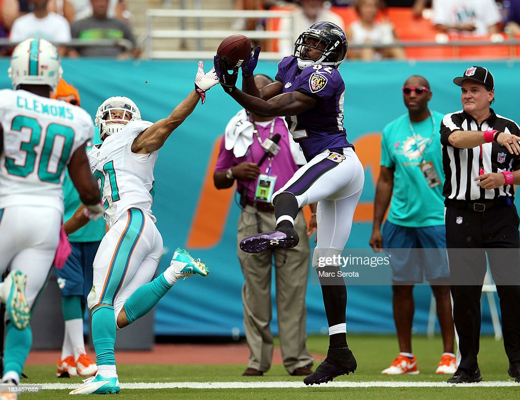 Receiver <a gi-track='captionPersonalityLinkClicked' href=/galleries/search?phrase=Torrey+Smith&family=editorial&specificpeople=5527843 ng-click='$event.stopPropagation()'>Torrey Smith</a> #82 of the Baltimore Ravens cannot make a catch as <a gi-track='captionPersonalityLinkClicked' href=/galleries/search?phrase=Brent+Grimes&family=editorial&specificpeople=4253995 ng-click='$event.stopPropagation()'>Brent Grimes</a> #21 of the Miami Dolphins is called for pass interference at Sun Life Stadium on October 6, 2013 in Miami Gardens, Florida. The Ravens defeated the Dolphins 26-23.