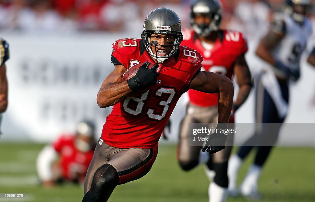 Receiver <a gi-track='captionPersonalityLinkClicked' href=/galleries/search?phrase=Vincent+Jackson&family=editorial&specificpeople=763433 ng-click='$event.stopPropagation()'>Vincent Jackson</a> #83 of the Tampa Bay Buccaneers runs after a catch against the St. Louis Rams during the game at Raymond James Stadium on December 23, 2012 in Tampa, Florida.