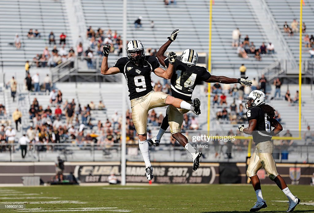 Receivers J.J. Worton #9 and Quincy McDuffie #14 of the Central Florida Knights celebrate a touchdown against the Alabama Birmingham Blazers during the game at Bright House Networks Stadium on November 24, 2012 in Orlando, Florida.