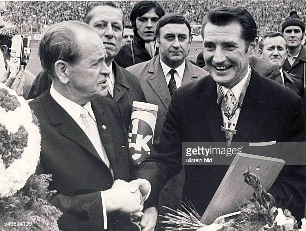 receiving the Federal Corss of Merit former coach of the German National Football Team Sepp Herberger congratulating Fritz Walter