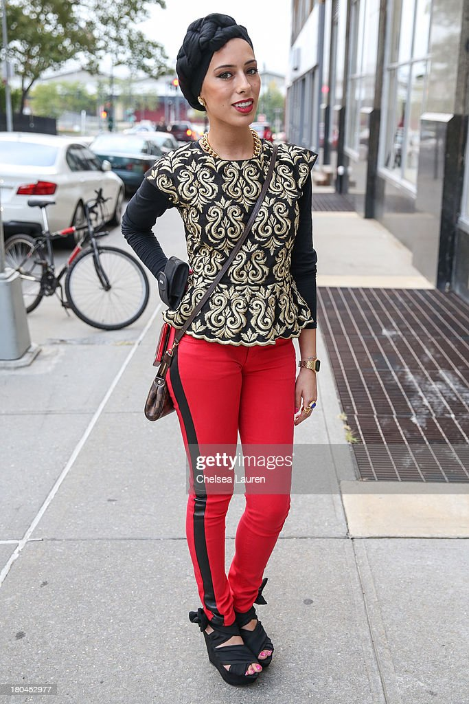 Recent interior design graduate Jasmin Ayad is seen wearing Juicy pants, Zara top, Hermes bracelet, Topshop shoes, Yves Saint Laurent ring and a Louis Vuitton purse at Streets of Manhattan on September 12, 2013 in New York City.