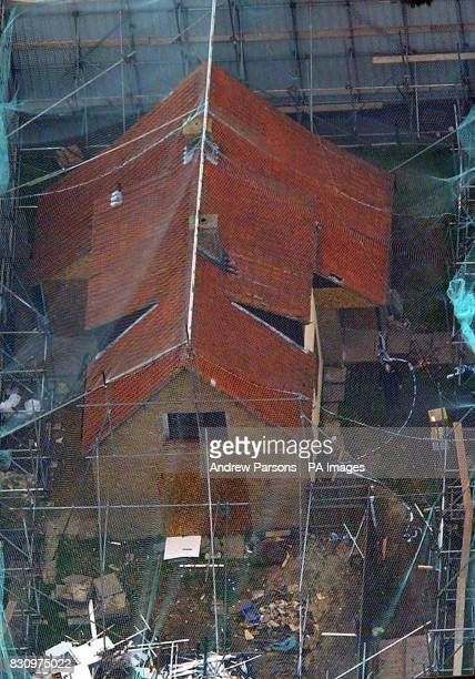 Recent photo of the home of murder suspect Ian Huntley in Soham Cambridgeshire which have been shielded from prying eyes by 30ft high green hoardings...