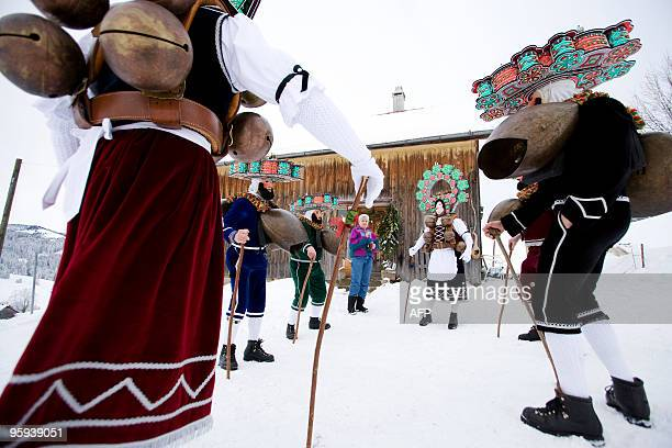 Recent picture of members of a 'Schuppel' dance in the snow pictured early in the morning during the 'Silvesterchalusen' in Urnaesch in the Swiss...