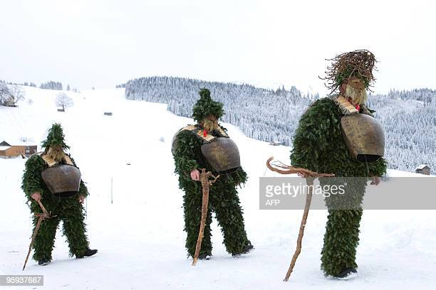 Recent picture of members of a 'Schuppel' walking in the snow early in the morning during the 'Silvesterchalusen' in Urnaesch in the Swiss canton...