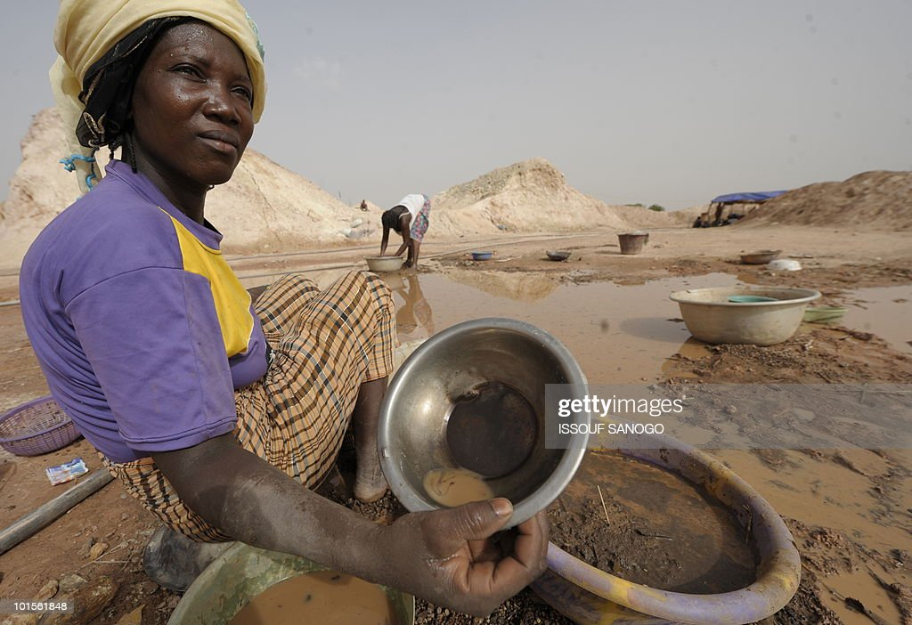 RETRAITE** Recent picture showing a woman sifting through mud as she looks for gold on the site of Namisgma, some 200 kilometers from Ouagadougou, Northern Burkina Faso on May 9, 2010. Gold in Burkina was until recently largely mined by hand despite the arrival of large gold mining companies lately.