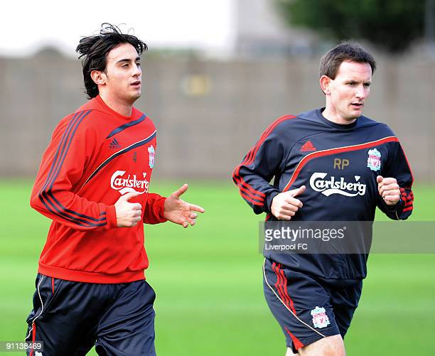 Recent signing Alberto Aquilani of Liverpool trains for the first time with Rob Price the senior physiotherapist during a training session at Melwood...