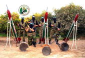 A recent undated handout photo made available July 4 2004 by the militant Palestinian Hamas group shows armed Hamas activists standing with their...