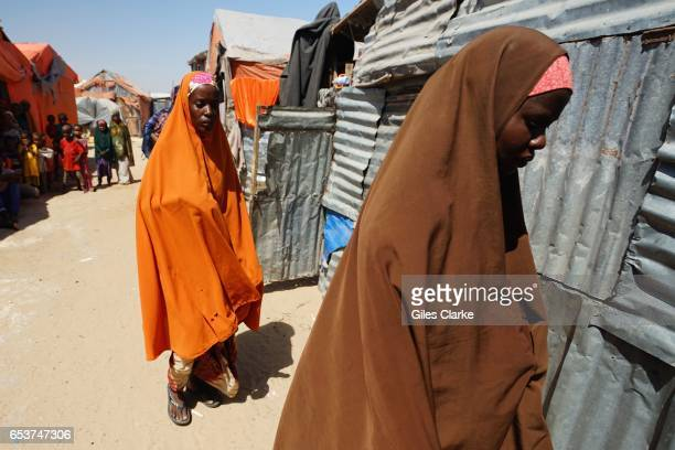 Recently arrived internally displaced women and children at a World Food Program center in Mogadishu Somalia Thousands of people have poured into the...