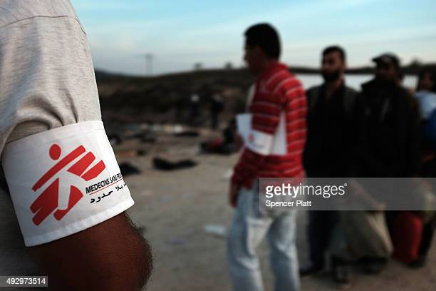 Recently arrived migrants line up for buses provided by the medical charity Doctors Without Borders after arriving from Turkey onto the island of...