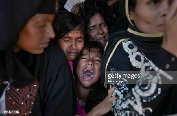COX'S BAZAR BANGLADESH NOVEMBER 30 Recently arrived Rohingya refugees queue for relief aid on November 30 2017 in Cox's Bazar Bangladesh Myanmar and...