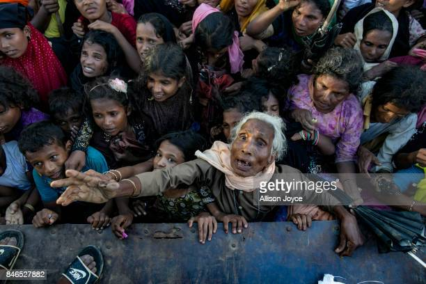 COX'S BAZAR BANGLADESH SEPTEMBER 13 Recently arrived Rohingya refugees wait to receive aid donations on September 13 2017 in Cox's Bazar Bangladesh...