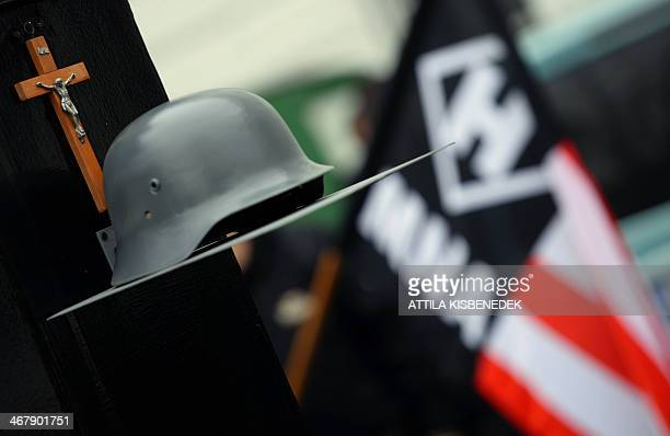 A recently built memorial place is seen with a German World War Two military helmet with a cross while a flag of right wing extremist Hungarian...