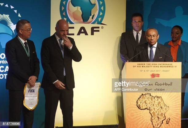 Recently elected president of the African Football Confederation Ahmad Ahmad speaks as Royal Moroccan Football Federation president Fouzi Lekjaa and...