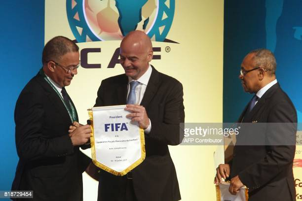 Recently elected president of the African Football Confederation Ahmad Ahmad FIFA president Gianni Infantino and Royal Moroccan Football Federation...