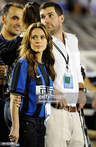 Recently engaged actress Alyssa Milano and Fiance Dave Bugliari follows the action on the soccer pitch during a friendly match bewteen Chelsea FC and...